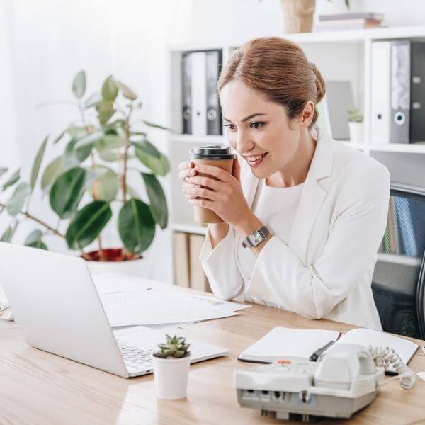 woman watching Beyond Burnout Training on her computer